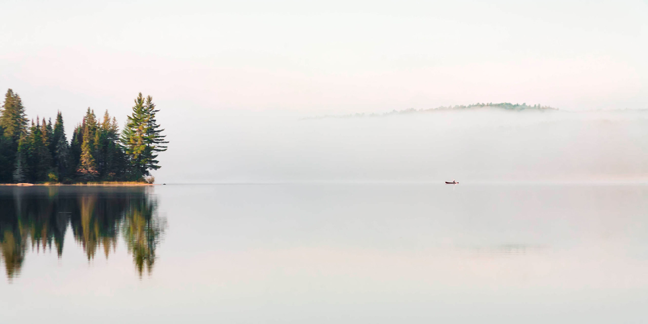 canoe in morning mist secluded lodge in algonquin park