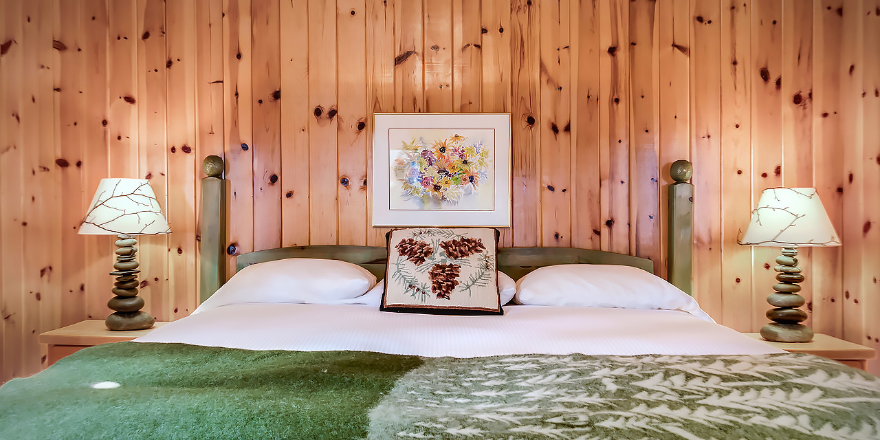 soft linens throw rug and cushion in canadian pine cabin