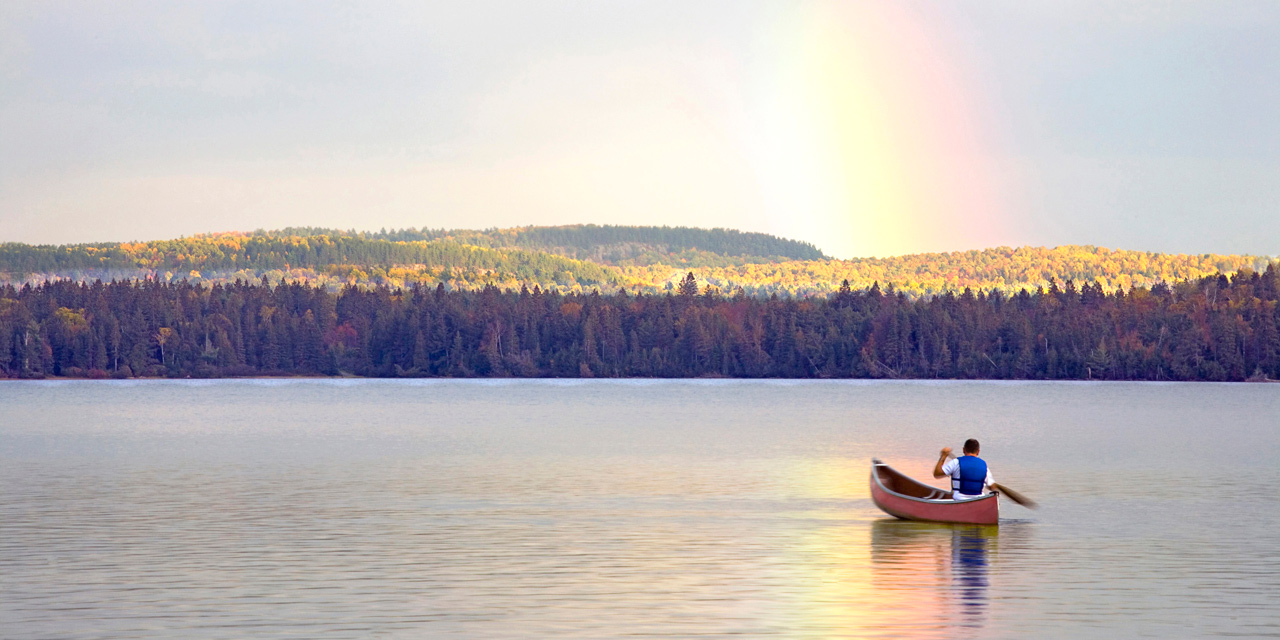canoeing under the rainbow on lake of two rivers ontario