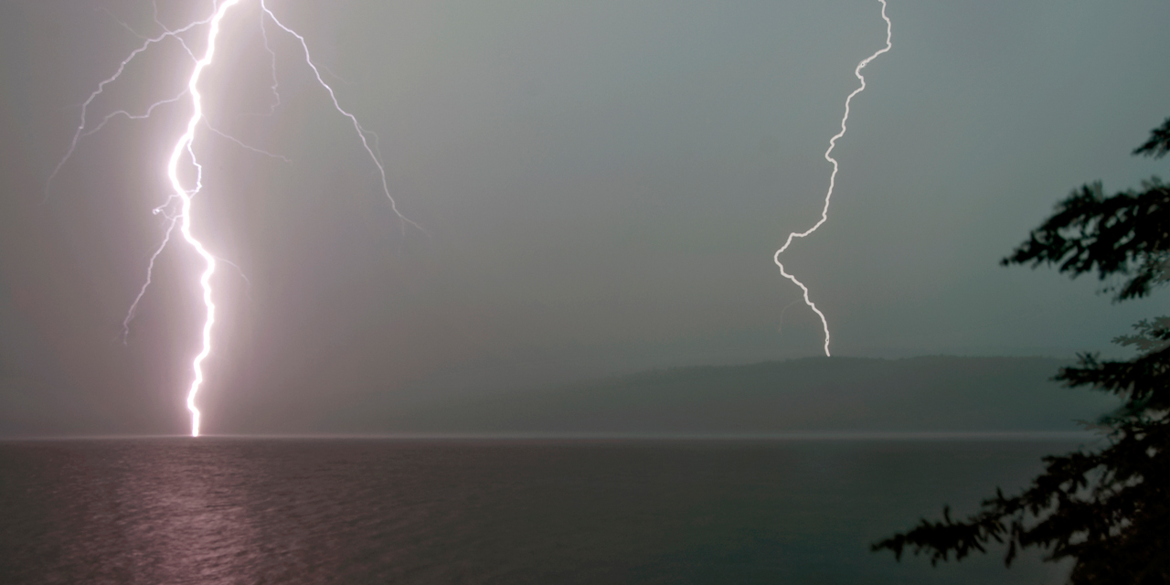 lightning strikes over lake of two rivers algonquin tour