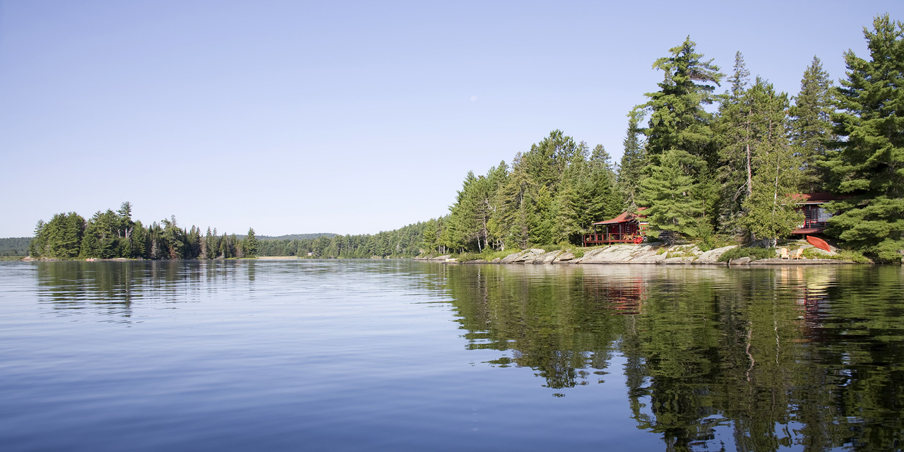 panoramic view of algonquin property from lake with cabins