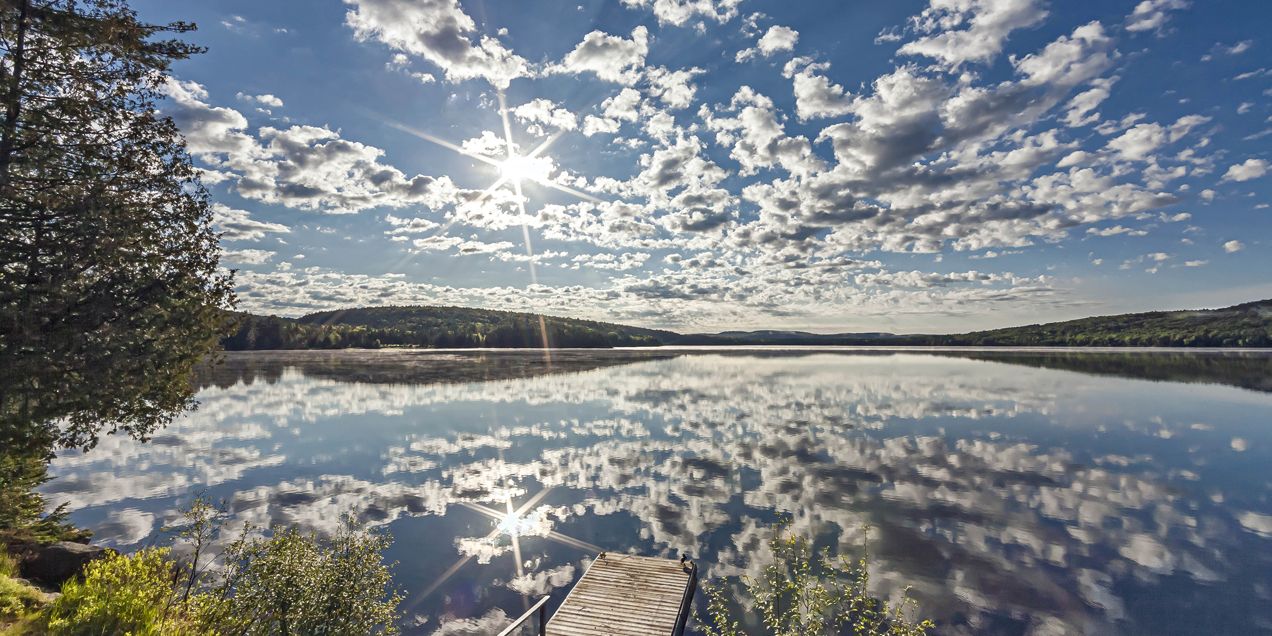 sunrise reflection over lake killarney lodge resort